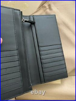 100% Authentic Burberry mens wallet. New With Tag And Box