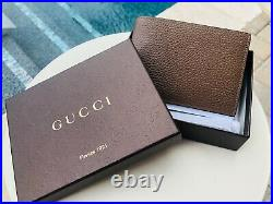 Gucci Men's 292534 Brown pebbled Leather bifold dollar Wallet embossed logo