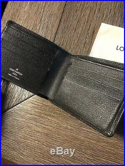 LOUIS VUITTON Black Taiga Leather Bifold Men's Wallet Discontinued LV France